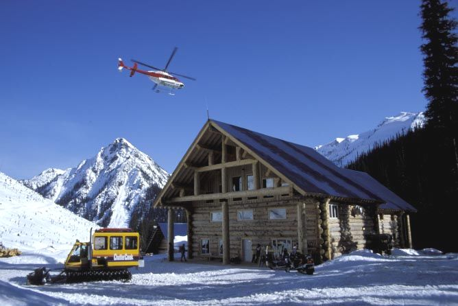 Chatter Creek lodge with snowcat and helicopter