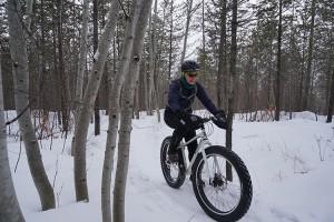 Linda Morris on a snow bike