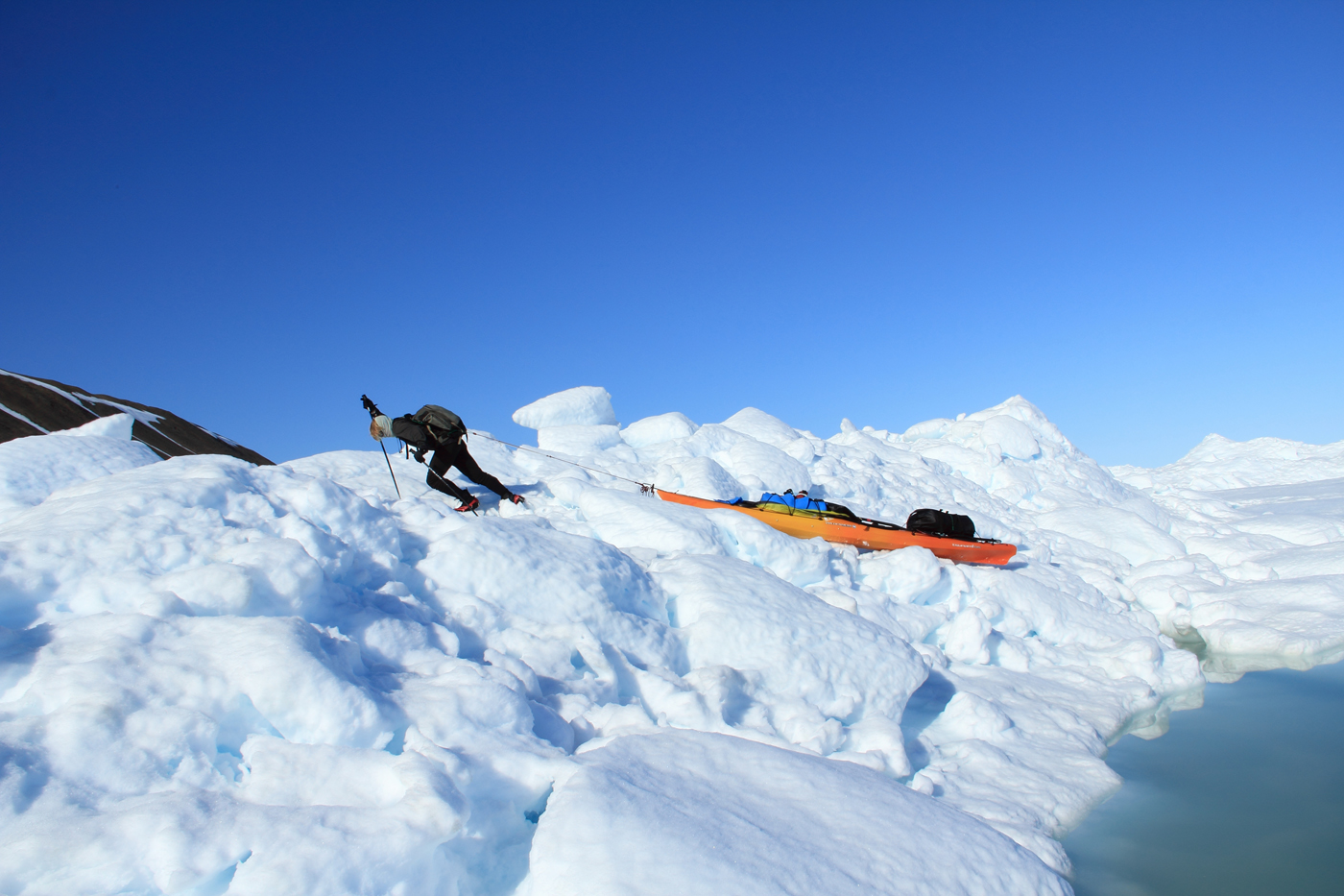 Erik Boomer pulling over a pressure ridge after we abandoned our skis.